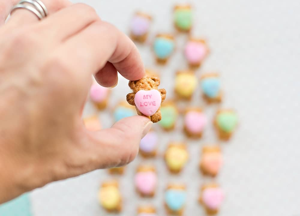 These Adorable Bear Holding Heart Cookies make a an cute and easy Valentine treat for kids or school lunch snack they can make themselves.