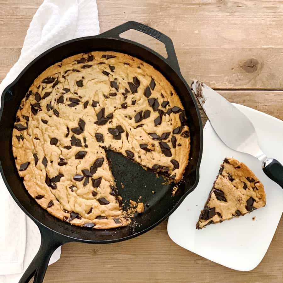 This gooey and delicious One Bowl Skillet Chocolate Chip Cookie comes together easily in one bowl and is a crowd-favorite dessert for kids and adults!