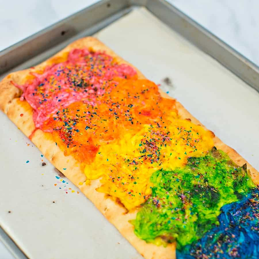 Our Rainbow Glitter Unicorn Pizza is the (easiest!) most magical pizza you'll ever eat. This stunning snack will be the healthy hightight of your party!