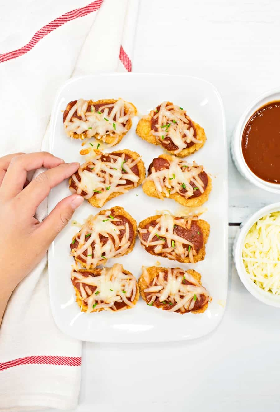 Serve up these crowd-pleasing easy chicken parmesan bites for a lunch or dinner that will get two-thumbs up from the whole family.