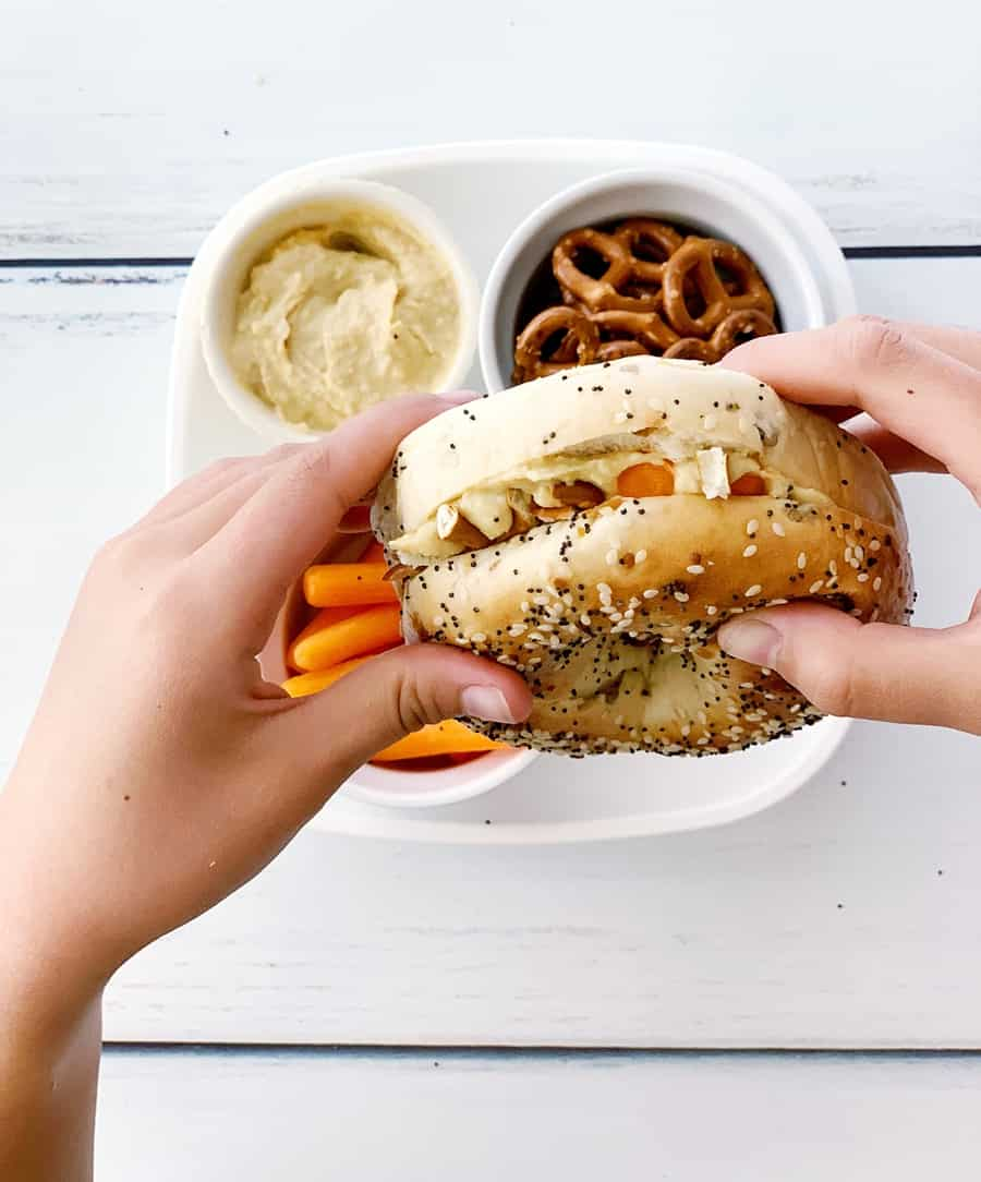 This Carrot Hummus Pretzel Bagel Sandwich is a hearty kids meal thatl combines a favorite flavor combination into one tasty and savory sandwich!