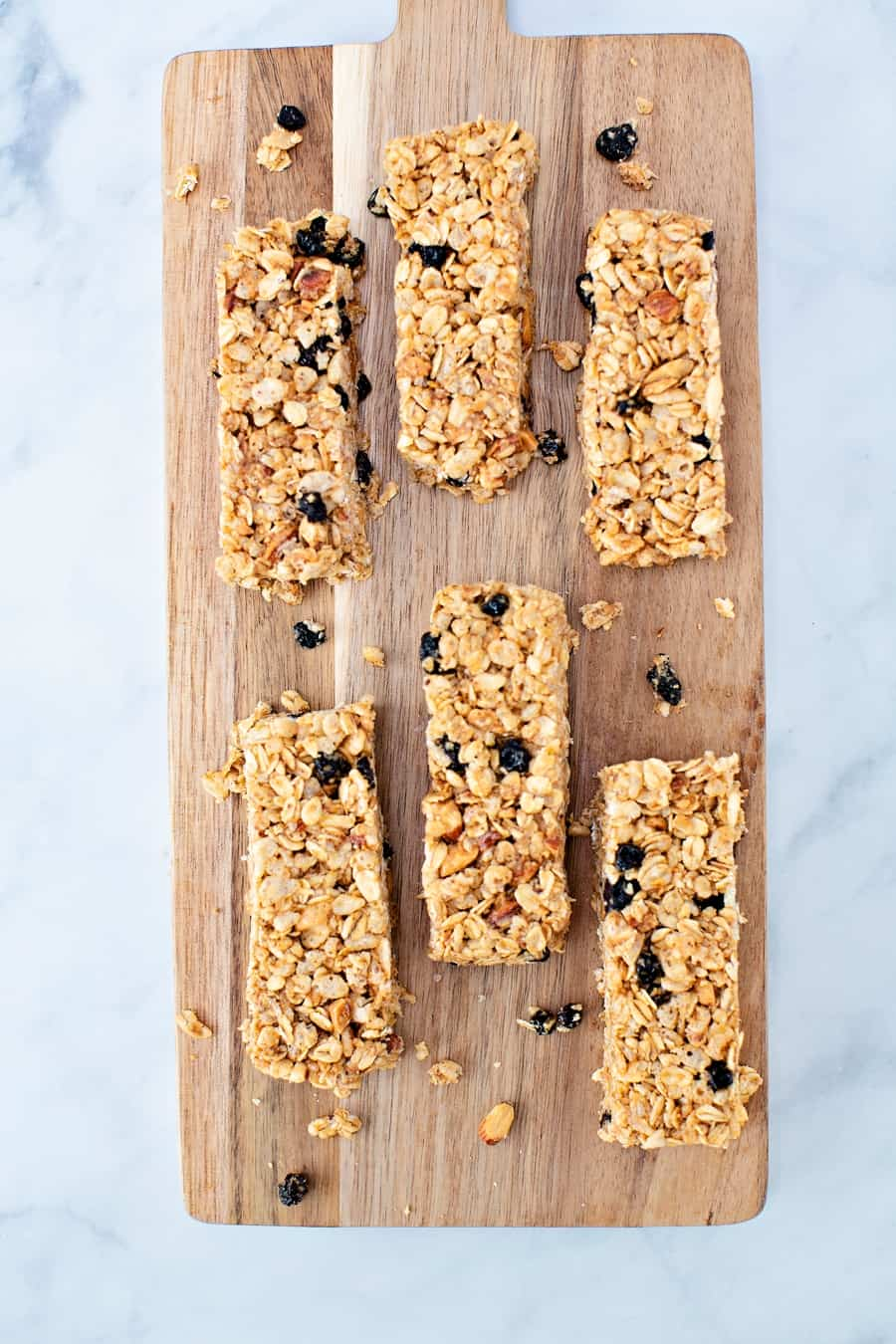 No Bake Blueberry Almond Granola Bars on a wooden cutting board
