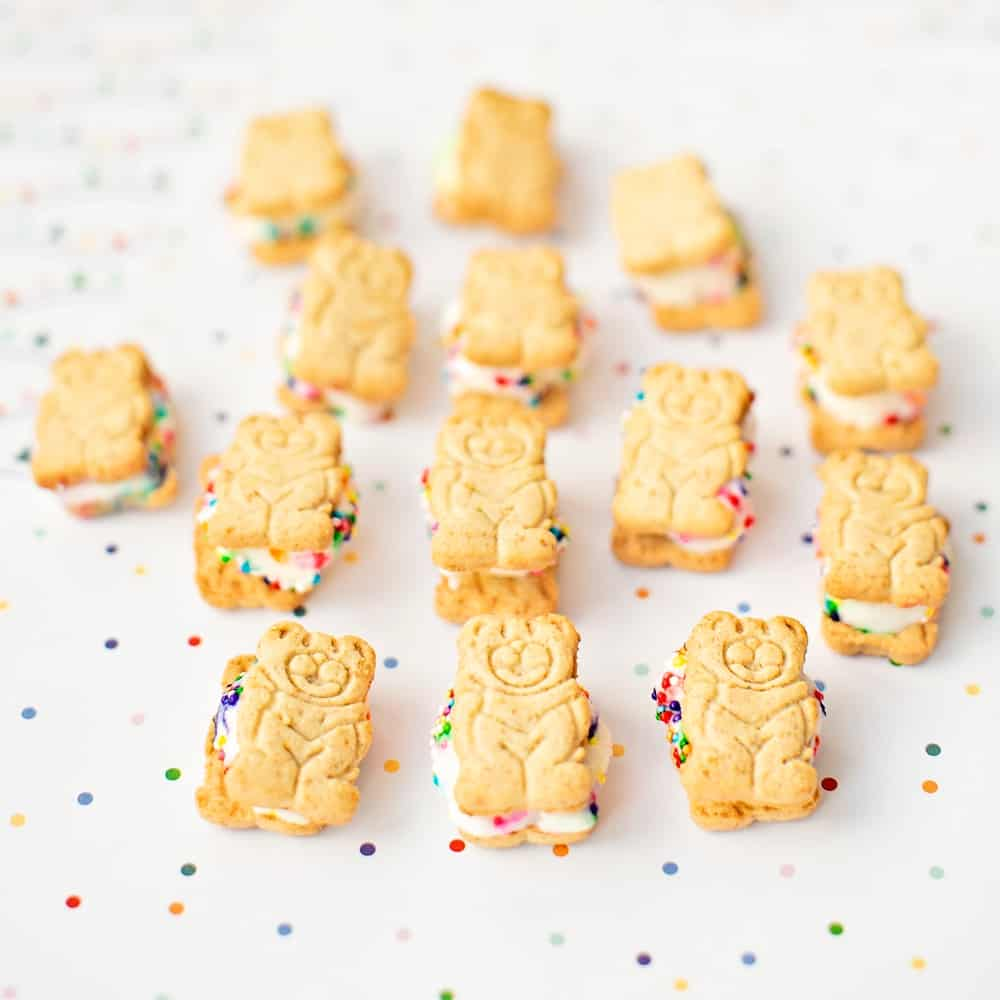 mini teddy bear graham ice cream sandwiches lying over rainbow dot paper
