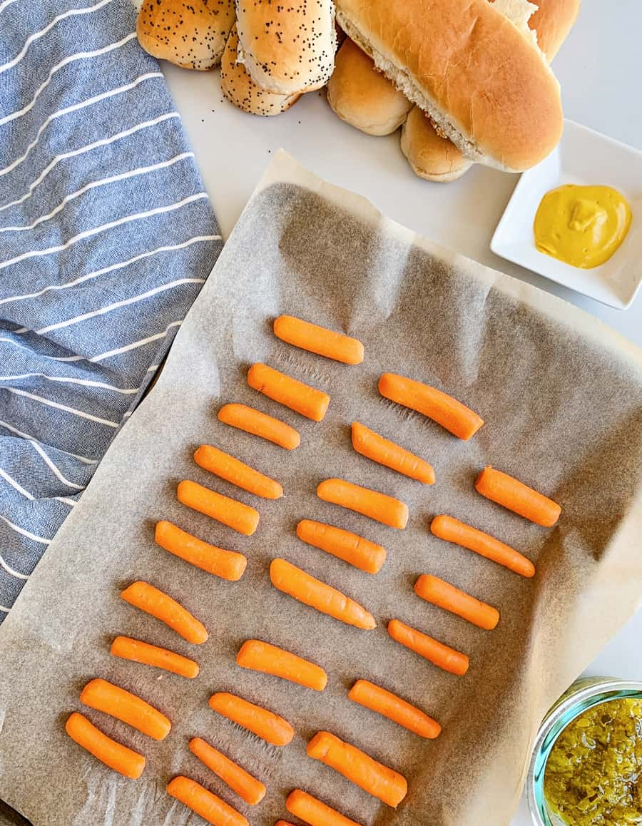 baby carrots on a roasting pan