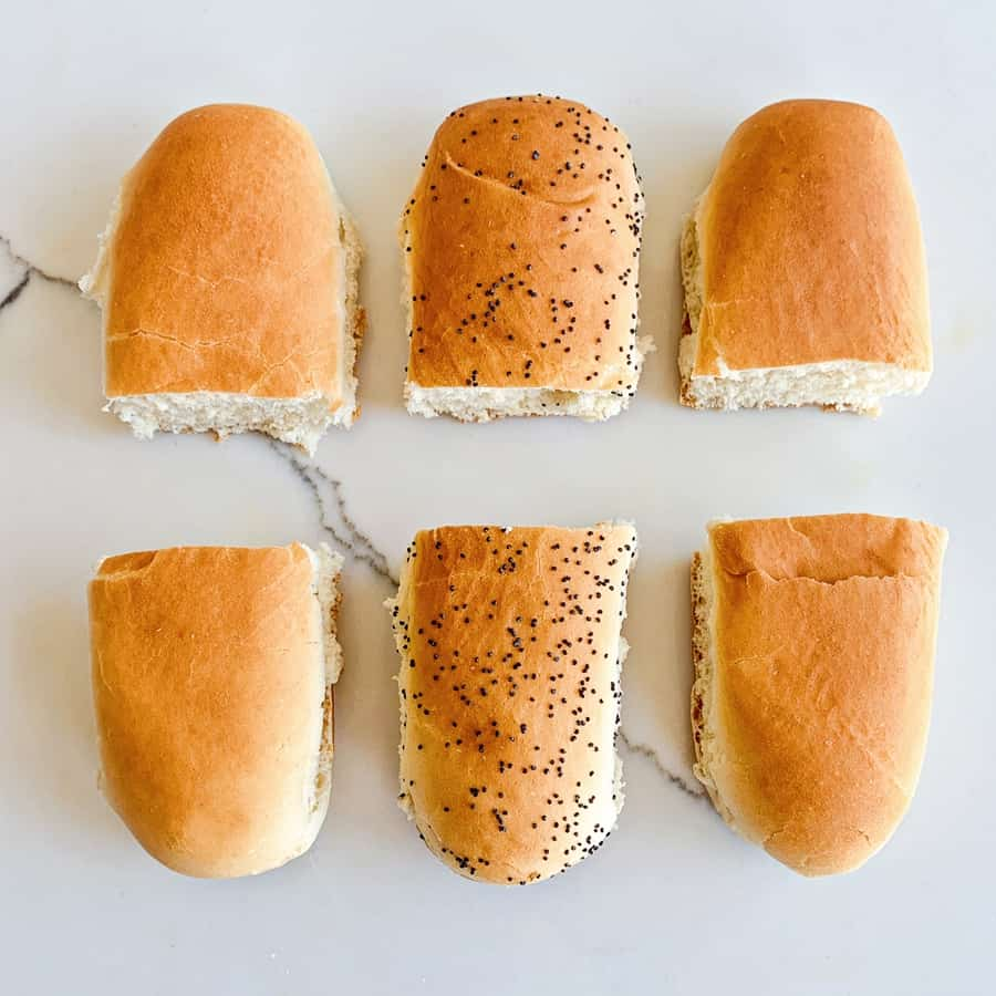 sliced hot dog buns in half