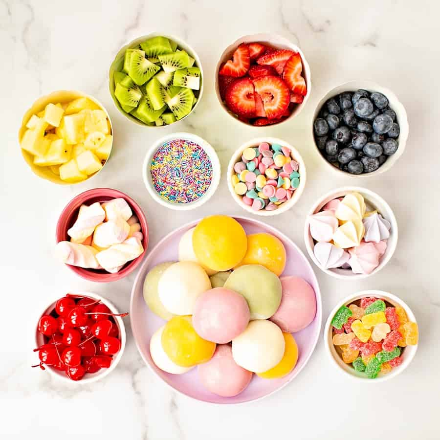 bowls of fruit, sprinkles and mochi ice cream