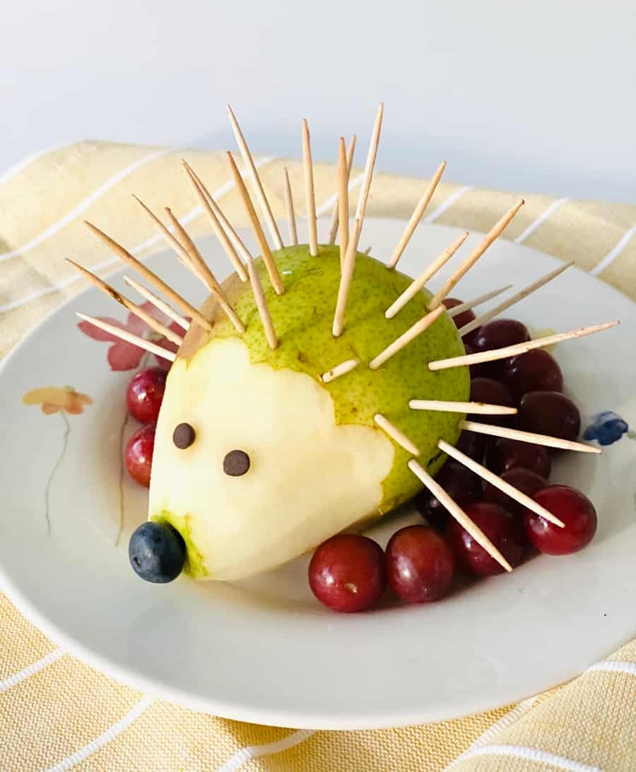 toothpicks inside a peeled pear to make a hedgehog