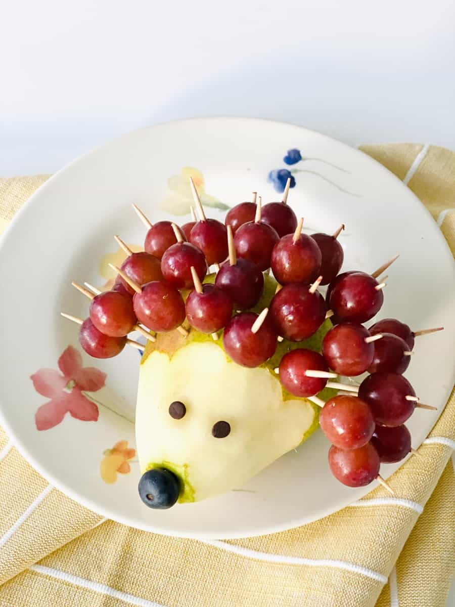 pear hedgehog made of grapes as quills