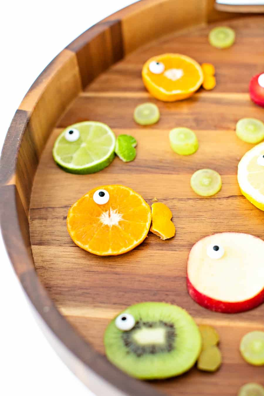oranges, limes, kiwi and apples cut to resemble fish fruit