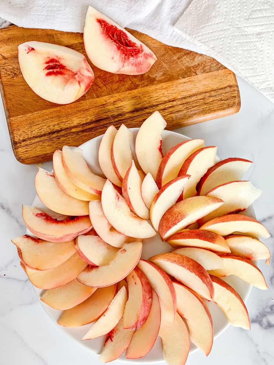 sliced peaches in a spiral to make fruit nachos