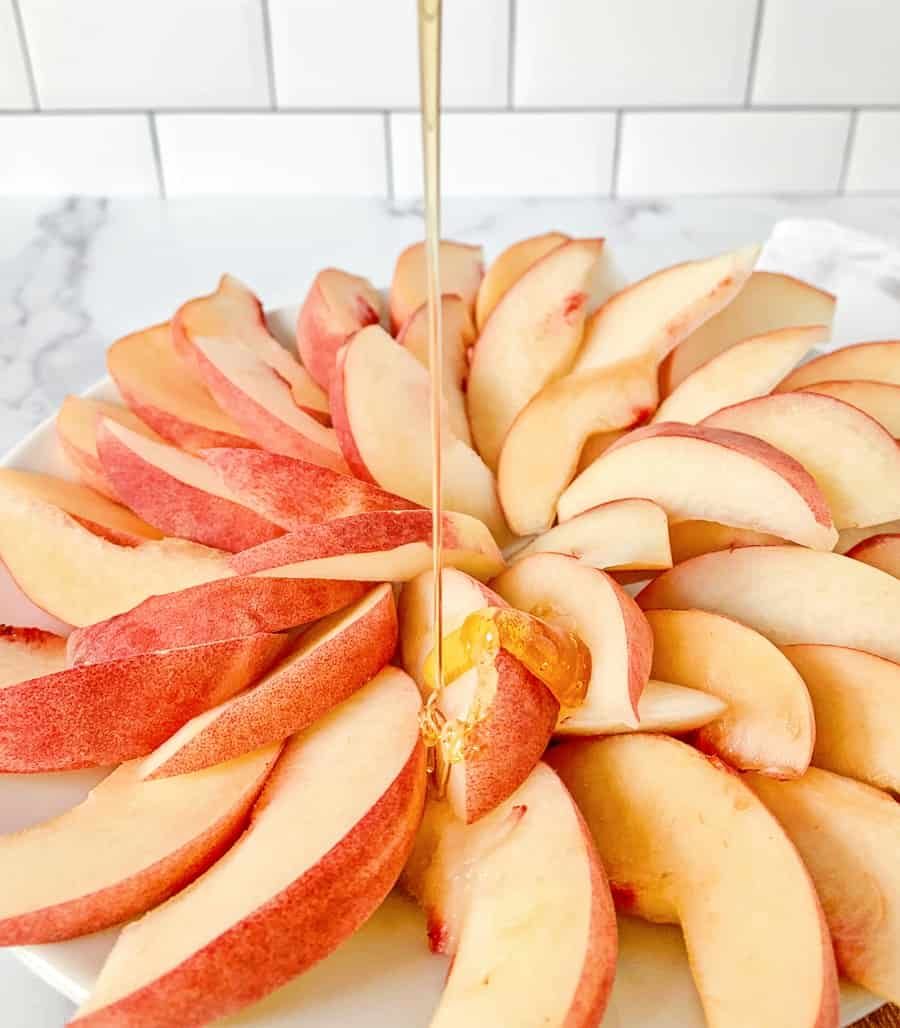 honey drizzled over sliced peaches