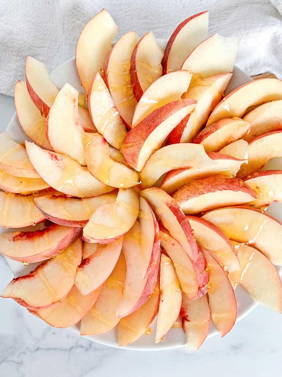 sliced peaches in a spiral to make fruit nachos