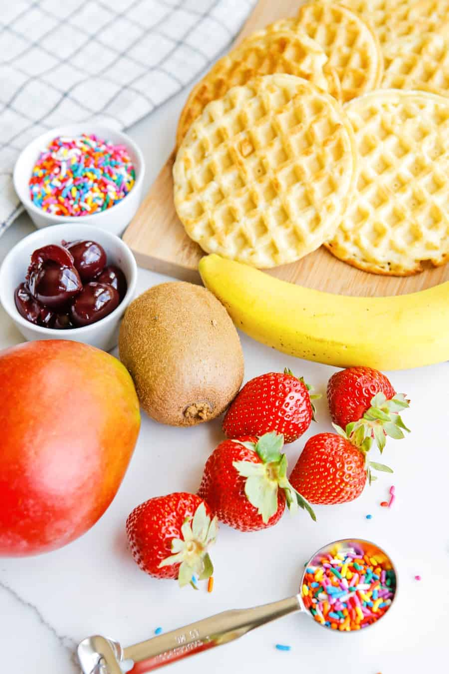 fresh fruit, sprinkles and waffle ingredients to make ice cream cone waffles