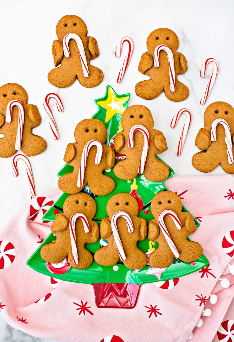 Gingerbread men cookies holding candy canes