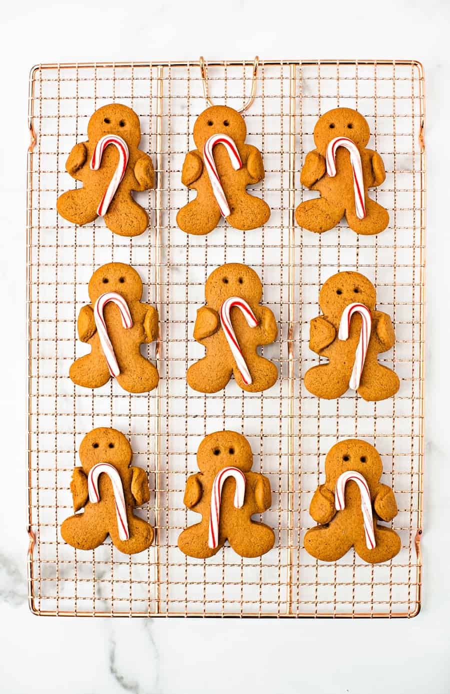 Gingerbread Holding Candy Canes Cookies