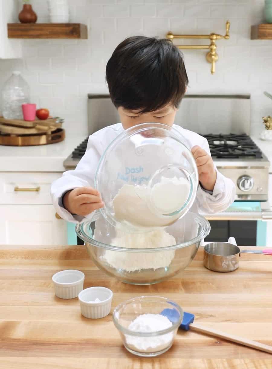 kids baking sprinkles cake